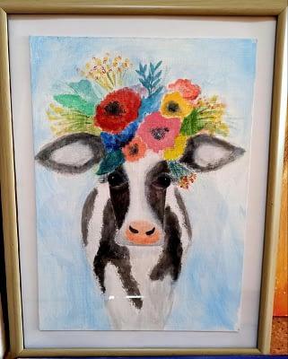 Детский рисунок коровы с венком.